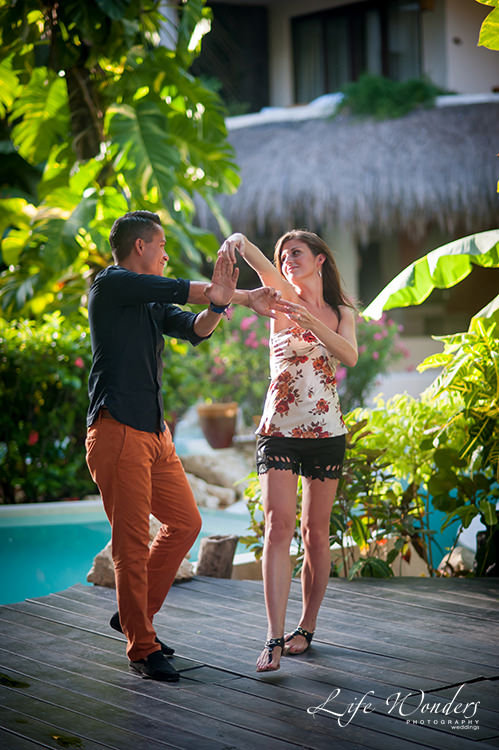couple dancing next to the pool - marriage proposals