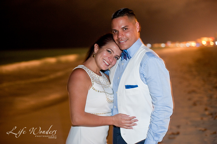 couple smiling for their cancun wedding photograph