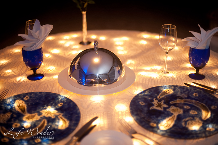 dinner table setting with lights