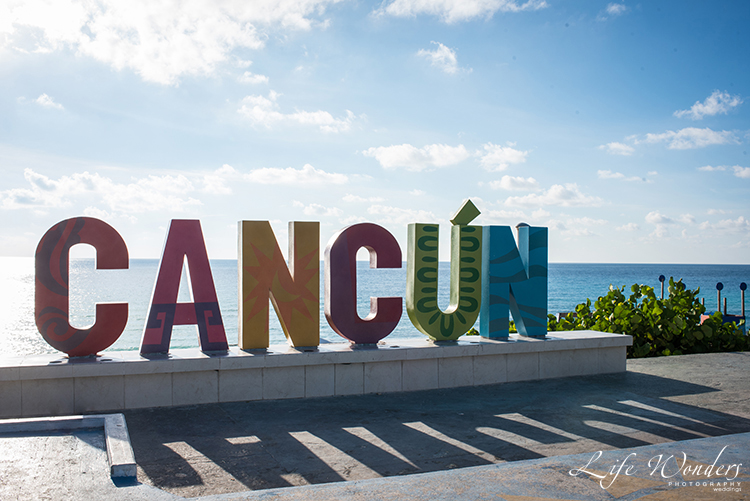 cancun beach colorful sign