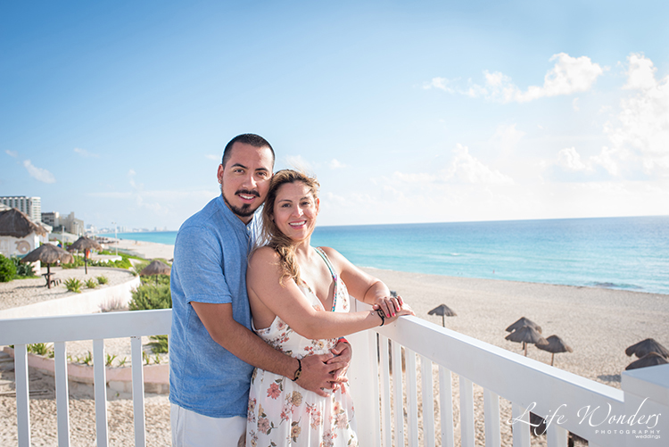 couple in balcony facing beach