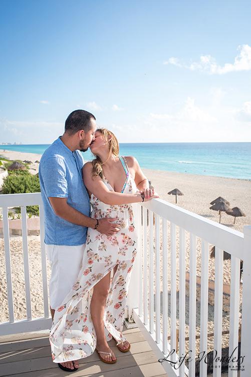 couple in balcony facing beach