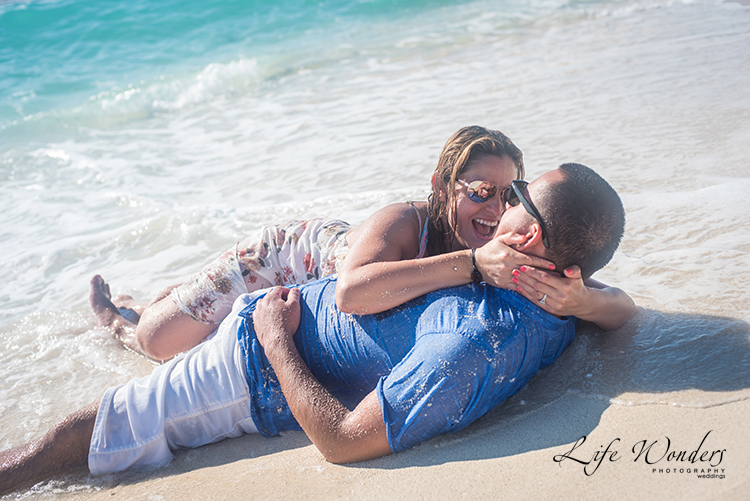 couple laying on the sand on cancun beach