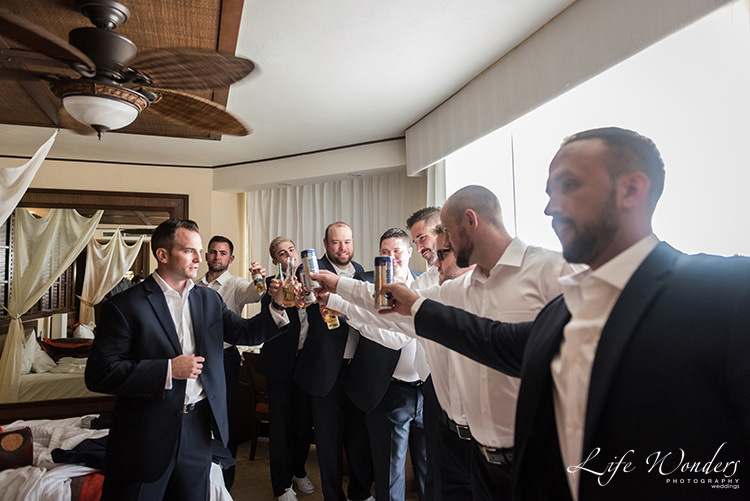 groom having a toast with groomsmen