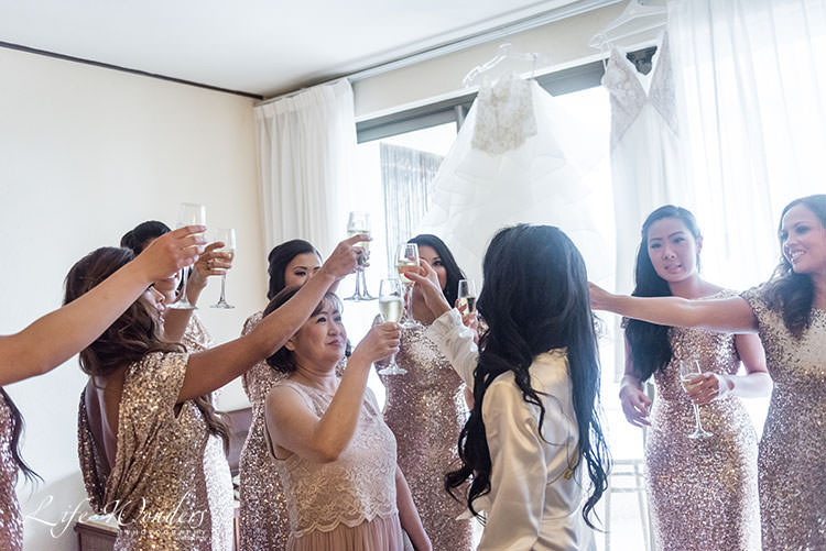 bride having a toast with bridesmaids