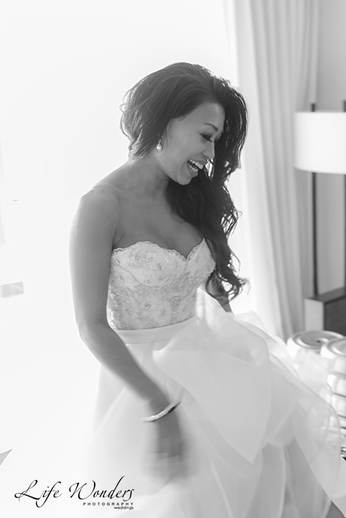 bride smiling in white wedding dress