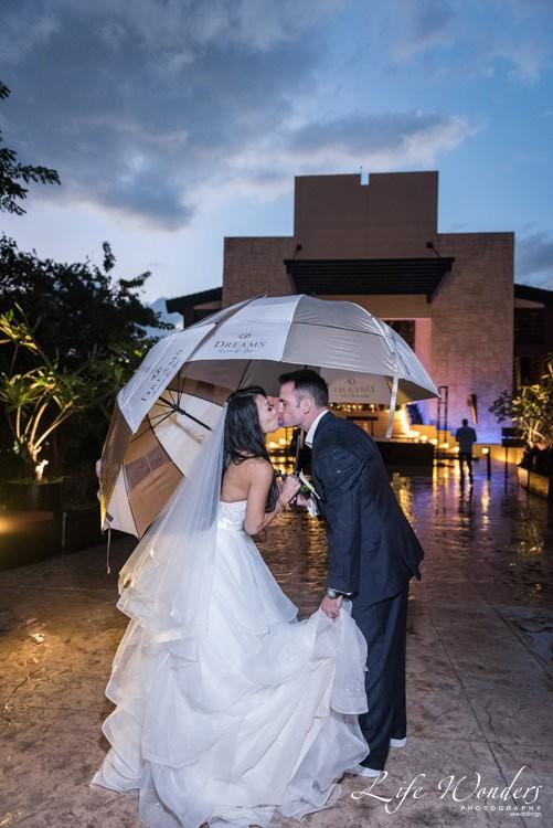 bride and groom wedding portrait in the rain