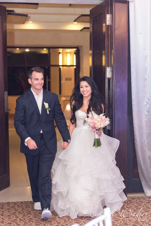 bride groom entering wedding reception