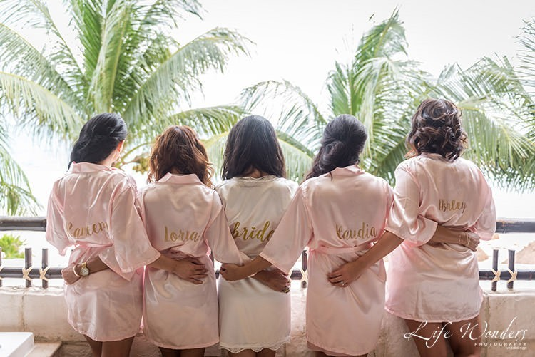 bride and bridesmaids in bridal robe