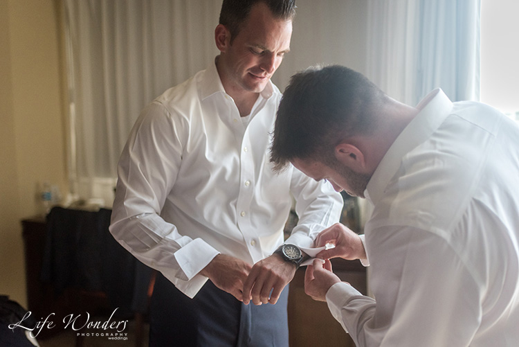 groom and groomsman getting ready