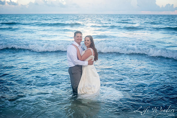 bride and groom in blue water