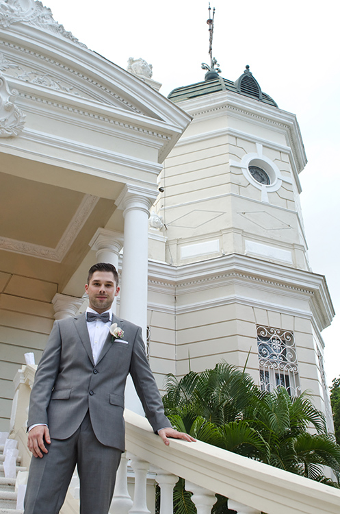 mexico wedding photographer groom on stairs