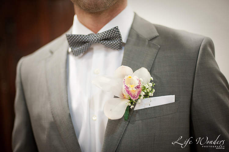 groom boutonniere and bow tie