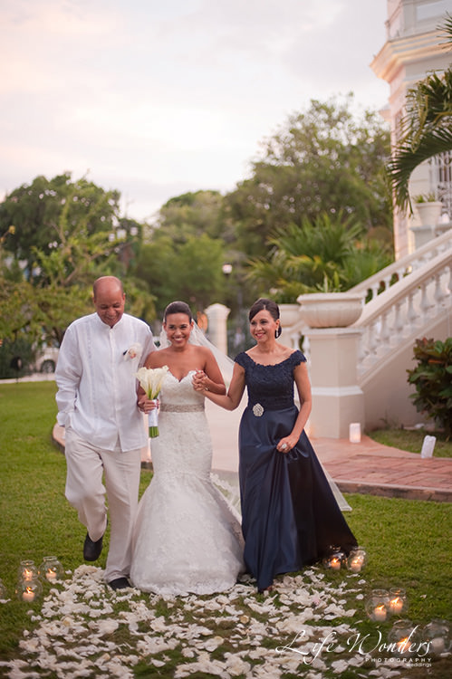 bride and parents walking the aisle