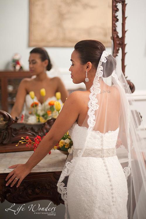 mexico wedding photographs bride in front of mirror