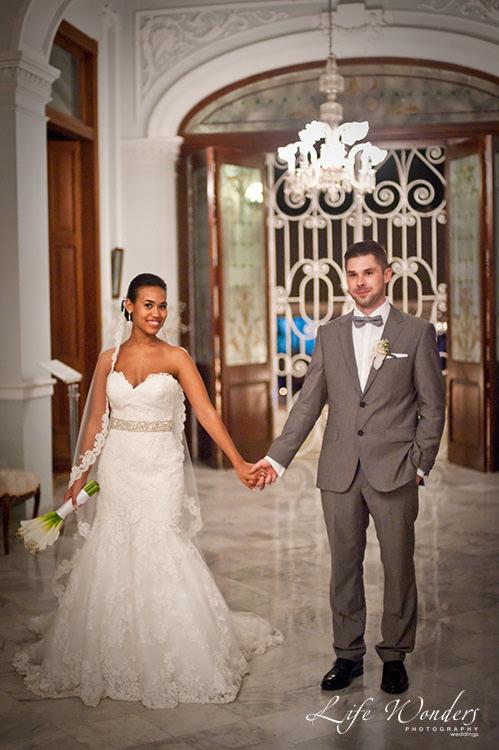 mexico wedding photographer bride groom holding hands