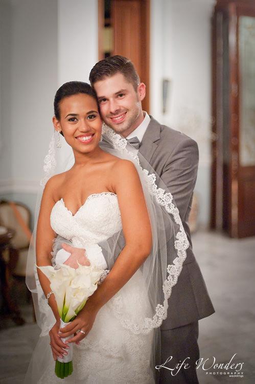 mayan wedding photographs groom backhugging bride