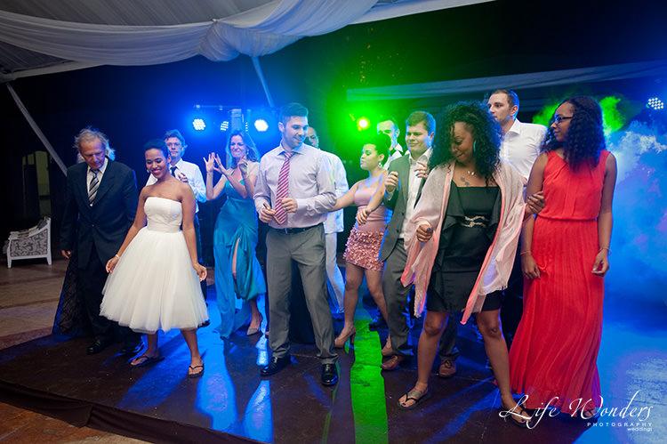 mexico wedding photographs bridal party dancing
