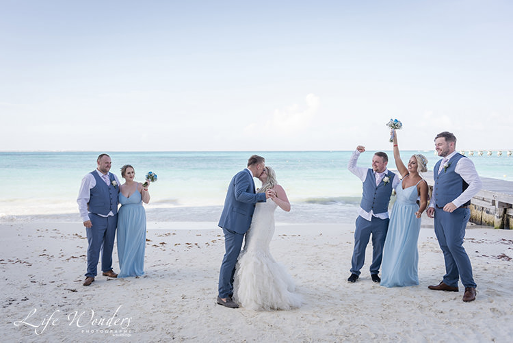 beach wedding ceremony bridesmaid jumping