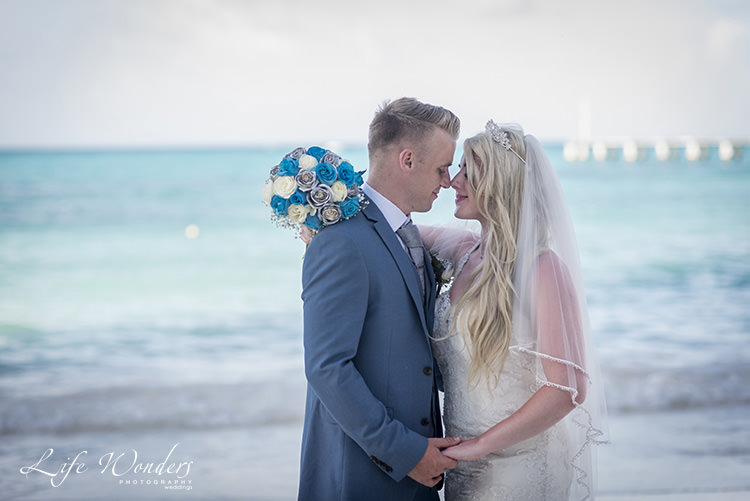 riu cancun beach wedding bride and groom intimate moment
