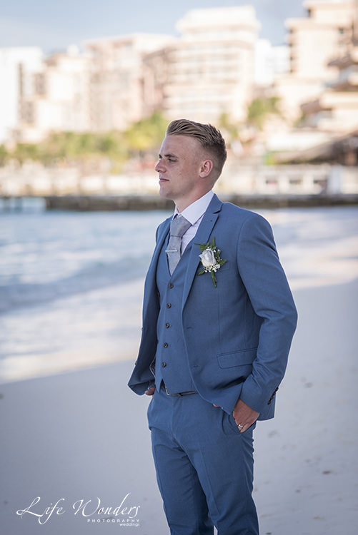 riu cancun wedding groom on beach