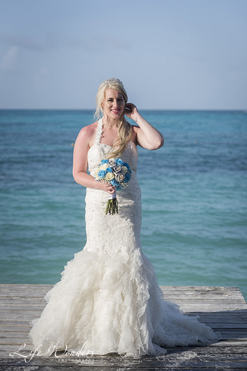cancun wedding photographer bride on pier