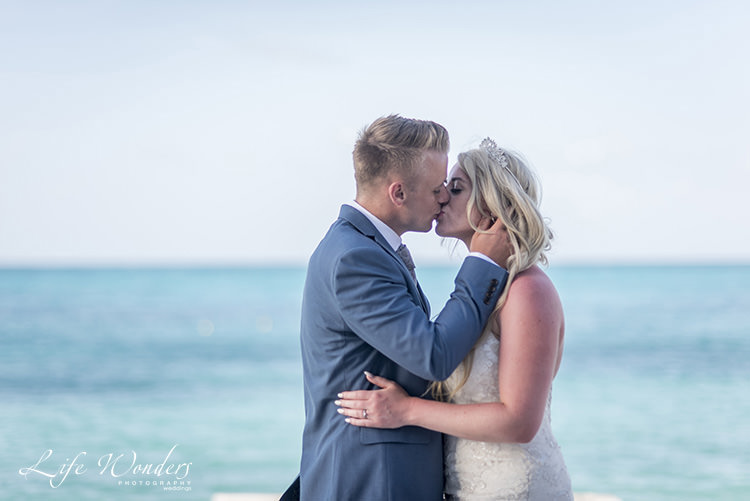 riviera maya wedding photographer bride and groom kissing