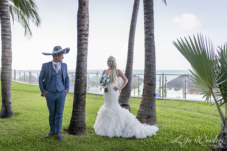 cancun wedding photographer bride with groom wearing sombrero