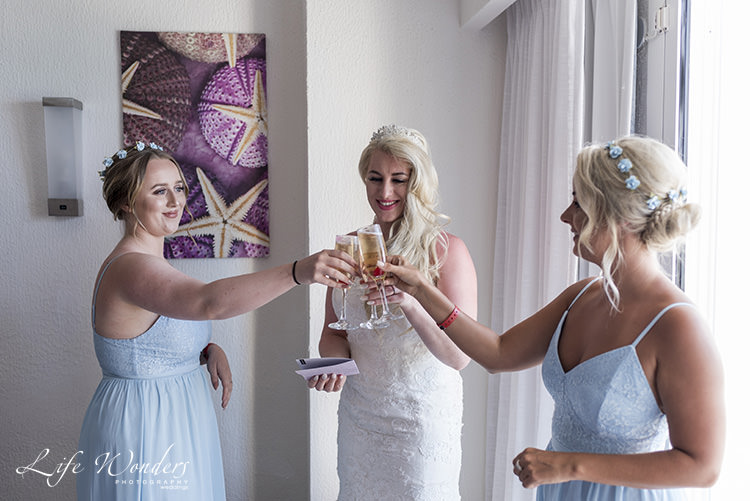 riu cancun wedding bride and bridesmaids toasting