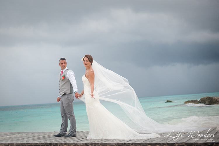 cancun wedding photography bride and groom on pier cloudy