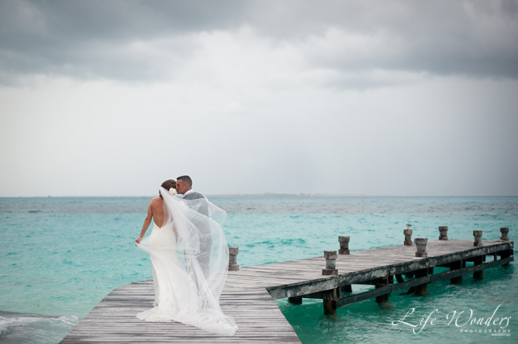 rain on wedding day in riviera maya bridal couple and clouds