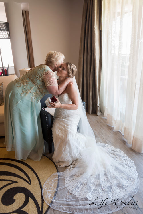 playa del carmen wedding mother of bride kissing bride