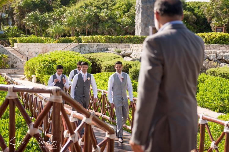 hard rock wedding groom groomsmen walking to ceremony venue