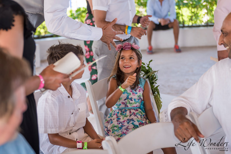 playa del carmen wedding young guests at ceremony smiling