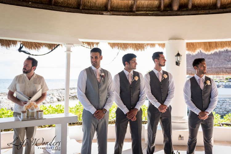 riviera maya wedding smiling groom groomsmen waiting for the bride
