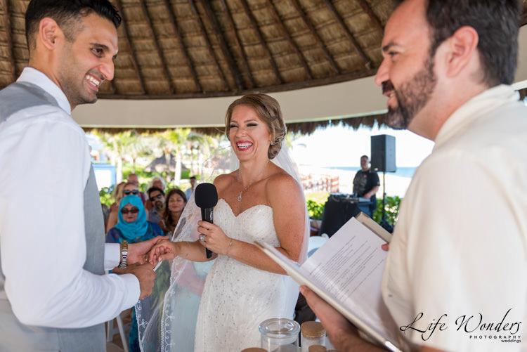 destination wedding photographer bride groom laughing in ceremony