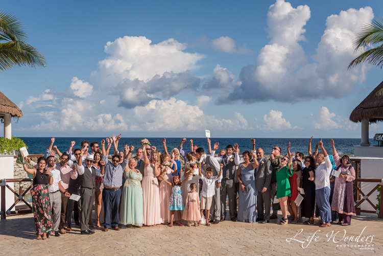 riviera maya wedding photographer happy bride groom and the whole family
