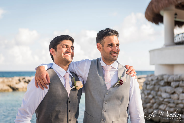 playa del carmen wedding photographer groom and his best man smiling