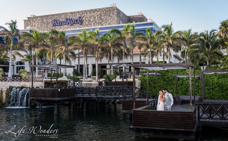 hard rock wedding bride groom photo session on dock