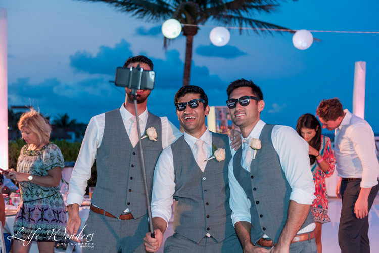 smiling groomsmen taking selfie