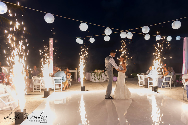 bride groom first wedding dance with fireworks on the background