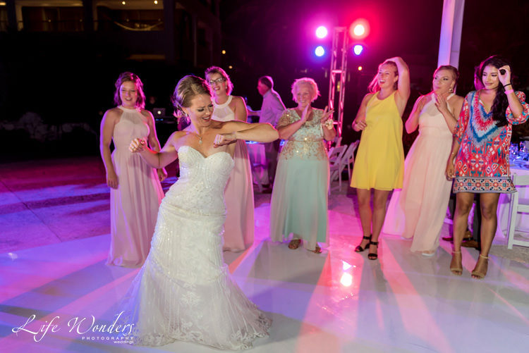 bride happily dancing with the guests
