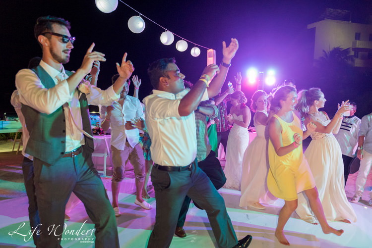 wedding reception guests happily dancing