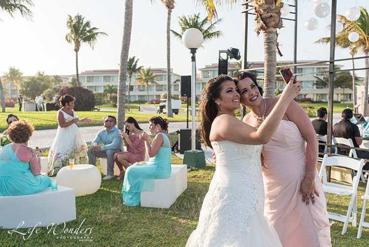 bride having fun at moon palace riviera maya wedding