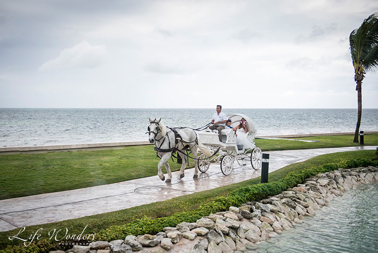 bride groom horse carriage at moon palace cancun wedding